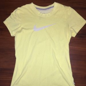 Nike yellow t-shirt.